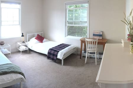 East Room with 2 beds - easy walk to light rail.