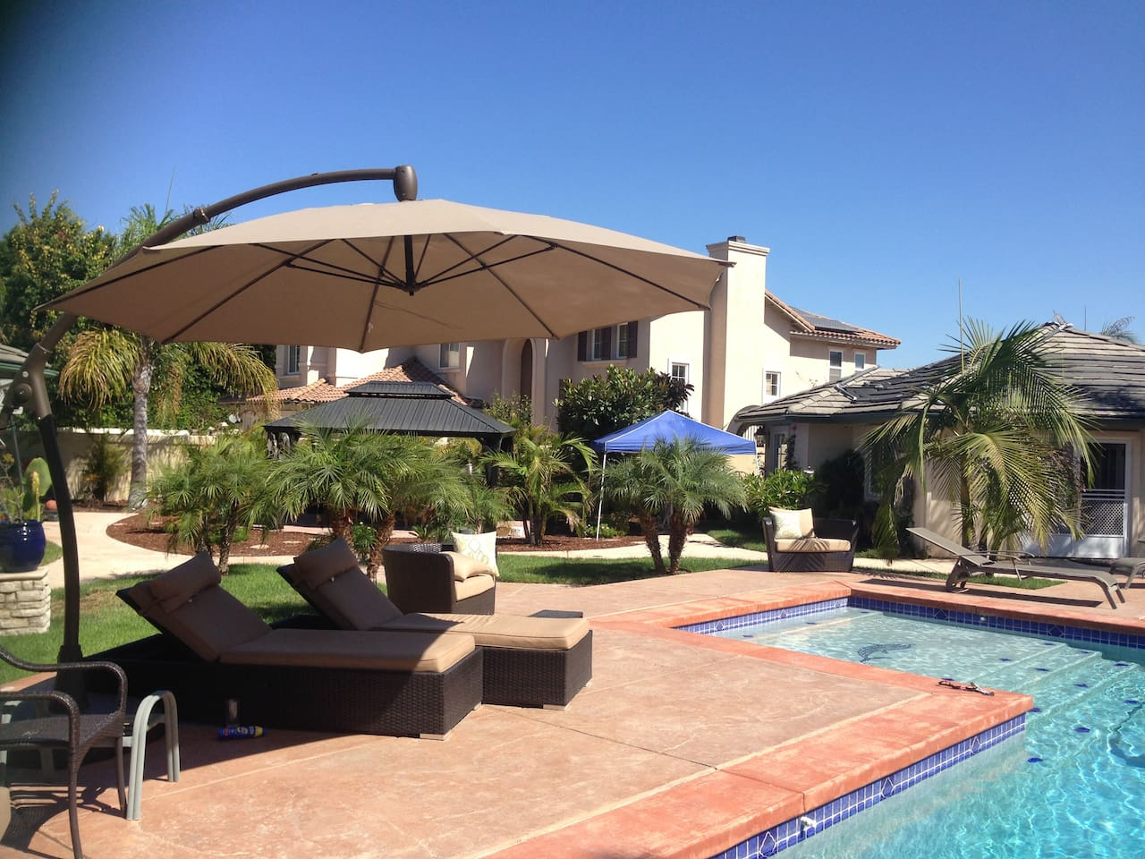 Lots of outdoor furniture to enjoy the pool!