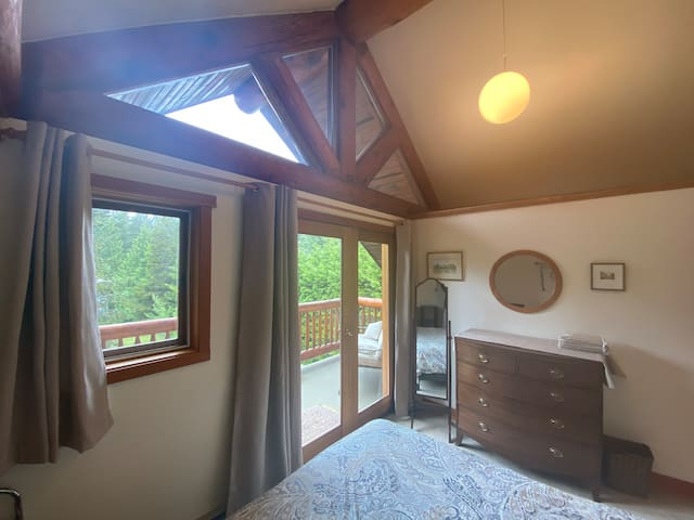 Guest room. Doors open to the 3rd story front patio.