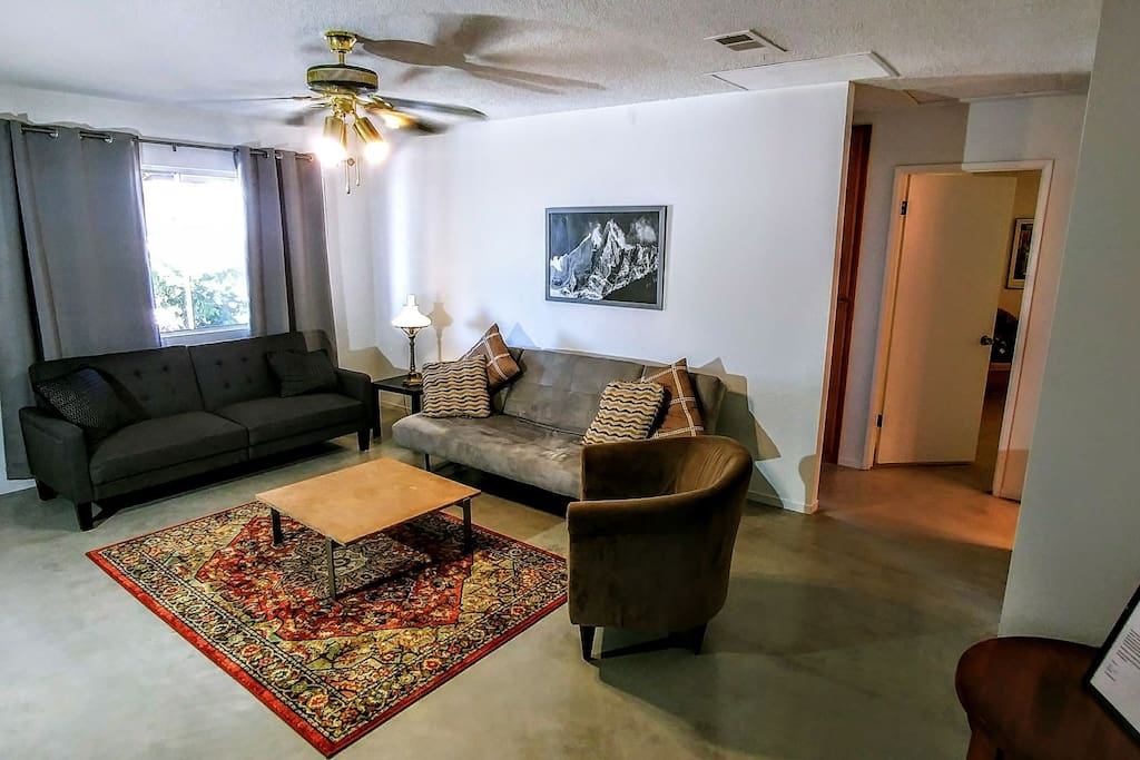 Living room with two couches that fold into Futon Beds