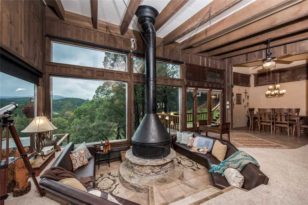 Spacious Living Room - Neeley Mountain House has large comfortable couches, cable HDTV, and ceiling fan so you can enjoy your evenings with family and lots of breathing space.