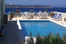 Joe's Bungalow in Mellieha  See Web site holidayrentalmaltagozo.com   Large Pool with Fantastic Sea Views