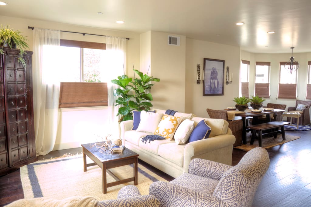 Cozy living room with plenty of seating to gather around the TV