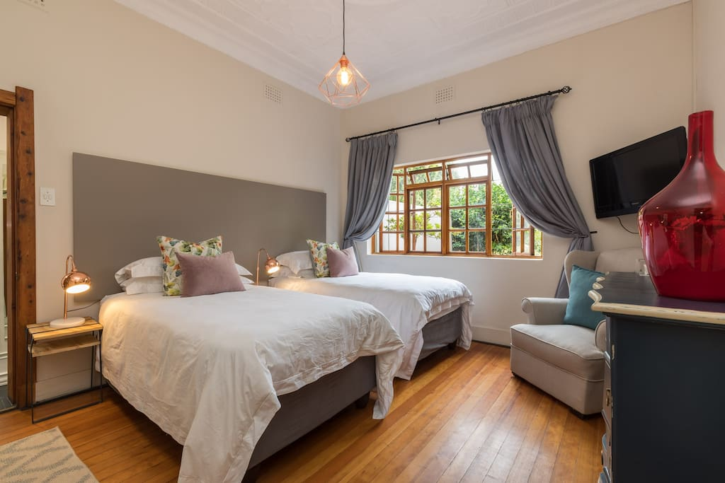 Main bedroom with two 3 1/4 beds, tv, decoder and on suite bathroom with both a shower and a bath.