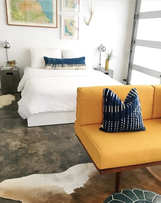 White linens and Bohemian pillows hand-crafted here in Venice decorate our sunny studio