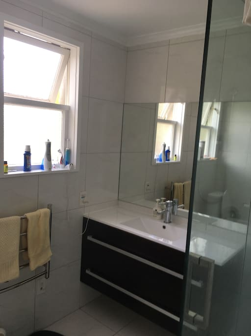 clean bathroom with room for your things.