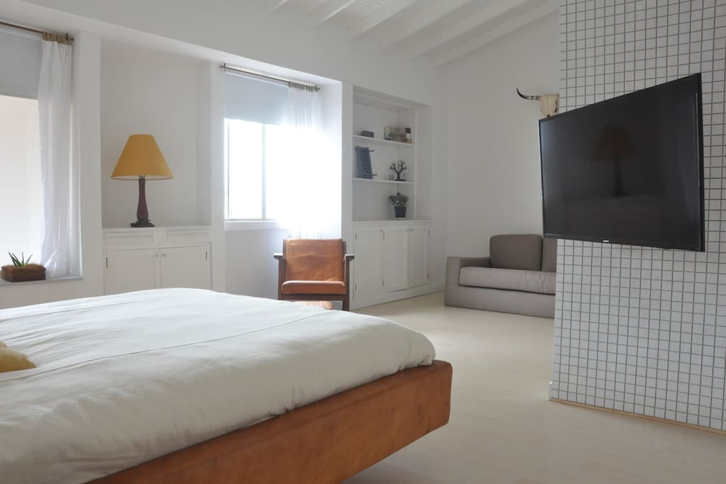 spacious bedroom, double bed, smart tv with international channels
