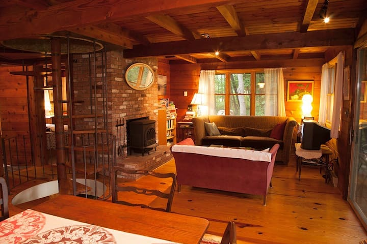 Very cozy living room with a wood burning stove.  There is also a bedroom on this main level.