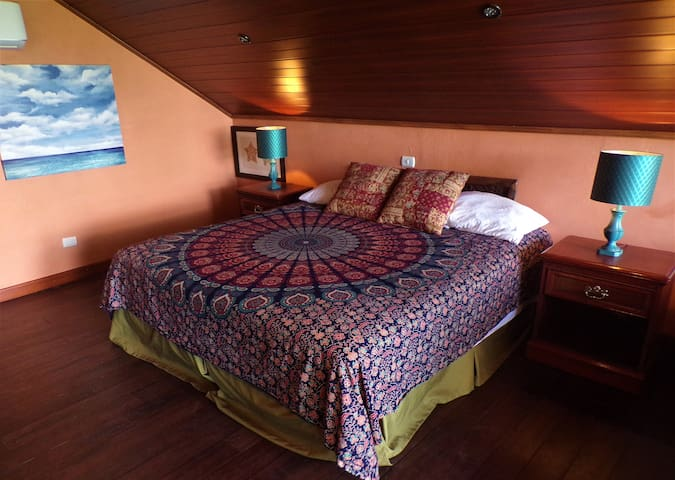 Bedroom 5B features a king bed, ceiling fan, air conditioning, private balcony and ocean view.