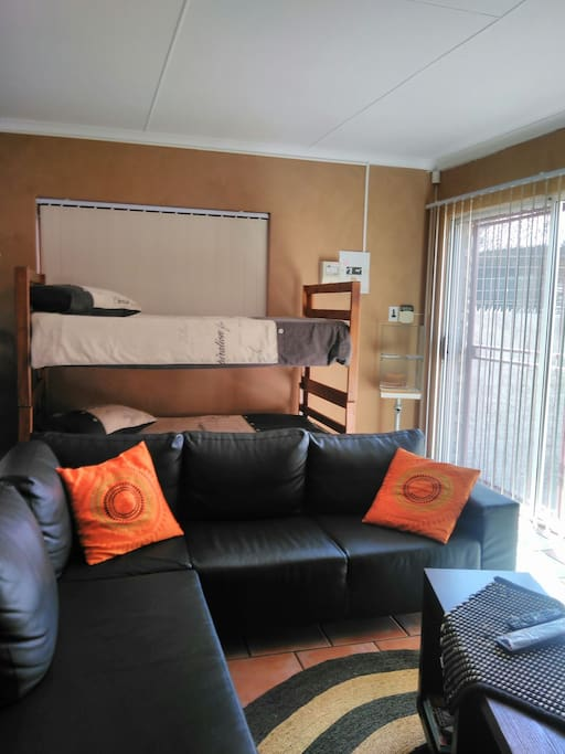 2 Single beds  (banker bed)  4 seater lounge area