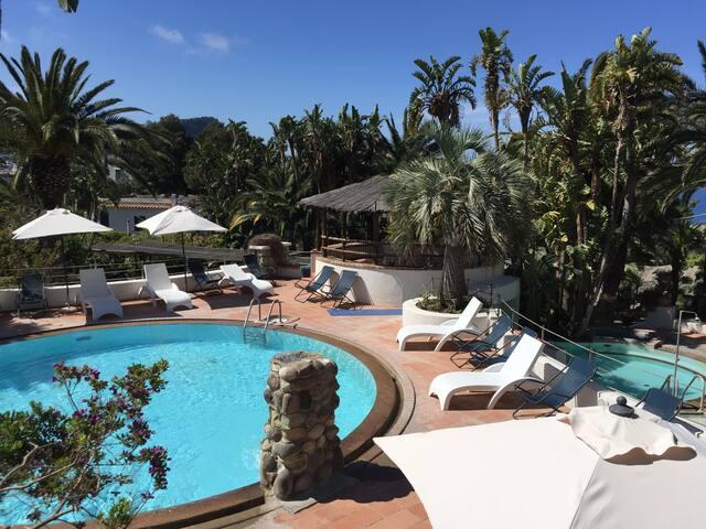 Studio appartement zwembaden en sauna in het paradijs