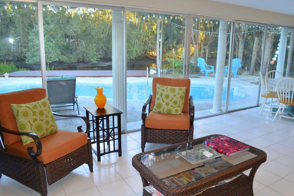 Enjoy Spending Time in the Bright Florida Room with Panoramic Views of the Pool and Waterfront! La-Z-Boy Brand Seating Set Along with a Round Dining Table that Sits 6 People!
