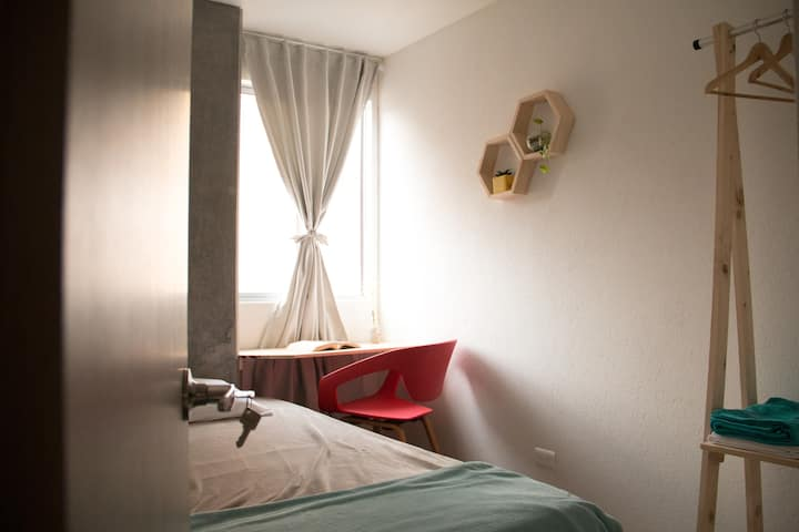 Room in comfortable Apt. in the heart of Medellin