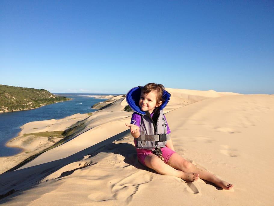 Grand daughter Jenna sitting ontop of highest sanddune