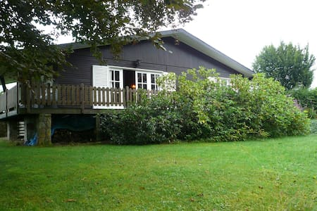 Detached chalet with views of the lake of Butgenbach in the middle of nature