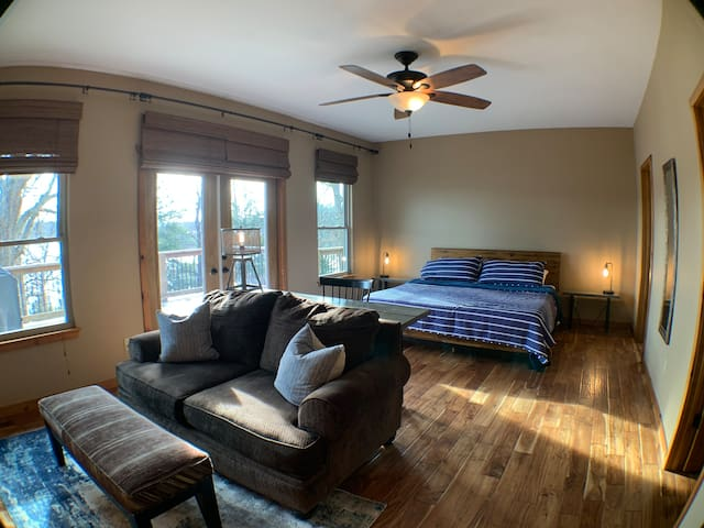 Primary Suite - King Bed with full bath, sitting space, TV, and walk-in closet