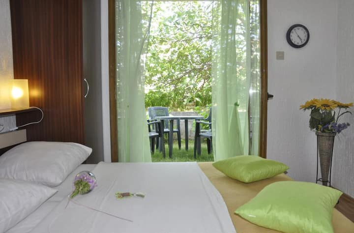 Two bedroom apartment with terrace Kampor, Rab (A-11878-a)