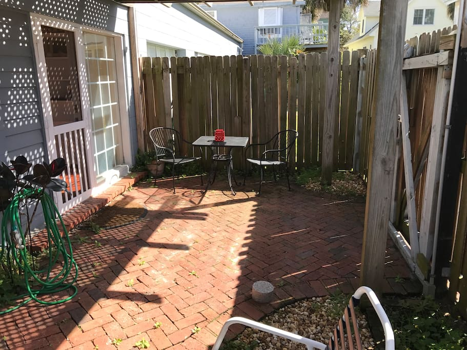 Private arbor shaded courtyard with lockable gate.