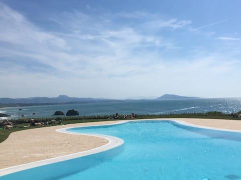 Studio vue d'exception Océan parking piscine tenni