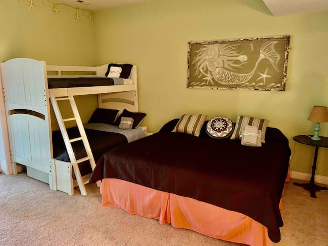 Lower Floor bedroom with king size bed and twin over queen bunk