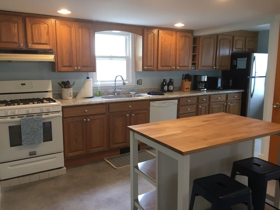 Kitchen with island, 2 stools, large pantry closet for storage. Stocked for dining in.