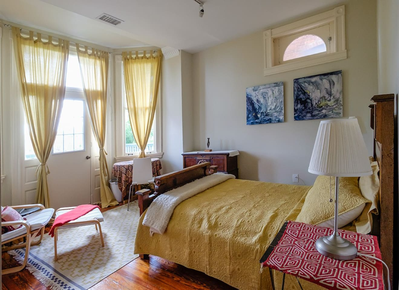 In the spring this room is the most beautiful one with a private porch , and a blooming wisteria