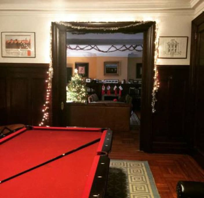 One living room extends to the other (pool table!) but can be closed off for privacy