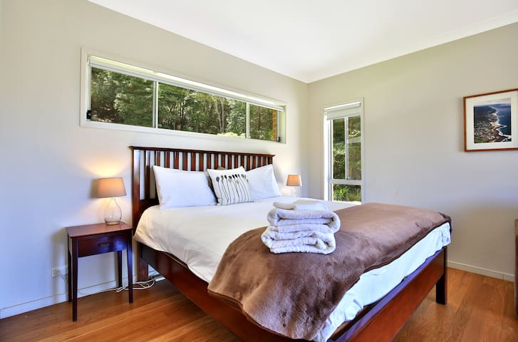 King Bed - private and comfortable. Enjoy garden and ocean vistas from bed.