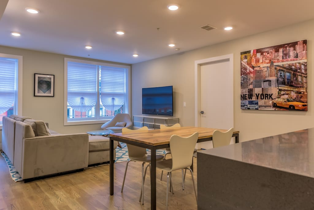The apartment's stylish décor includes denim blue accents, beautiful black and white photographs of iconic NYC landmarks and fun, splashy collages.