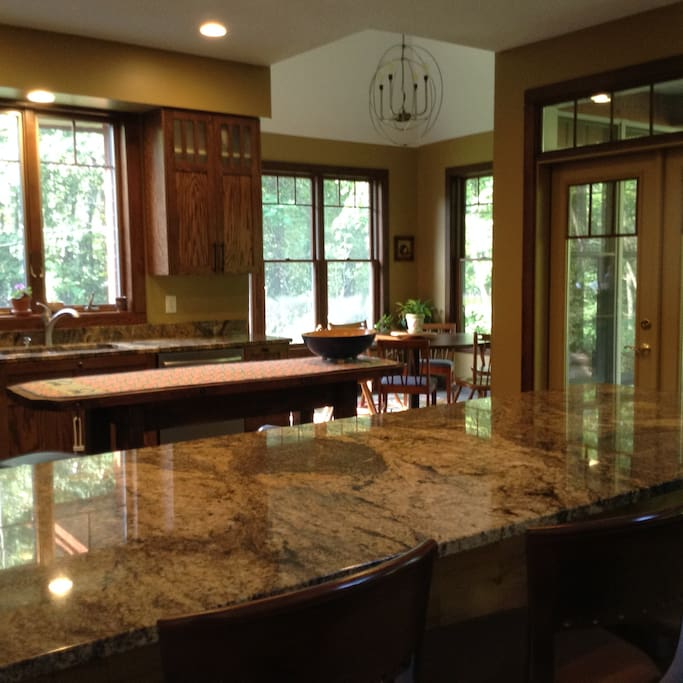 Kitchen with large round table, easily seats 8.