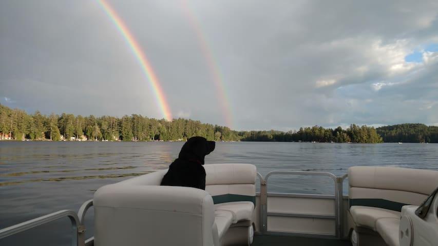 The Blythewood Island mascot enjoying an evening boat ride and double rainbow.