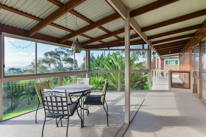 It is a covered outdoor patio with lovely views and can be used in any weather . It has a round table with 4 chairs to facilitate a leisurely breakfast in the morning or sit with a glass of wine in the evening for a great experience.