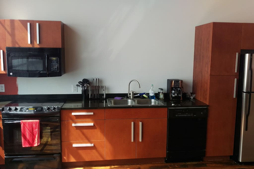 full kitchen with coffee maker and nice coffee selection