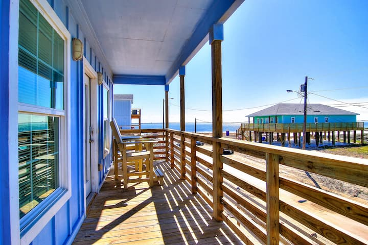 Enjoy breathtaking bay views from the comfort of a large front deck.