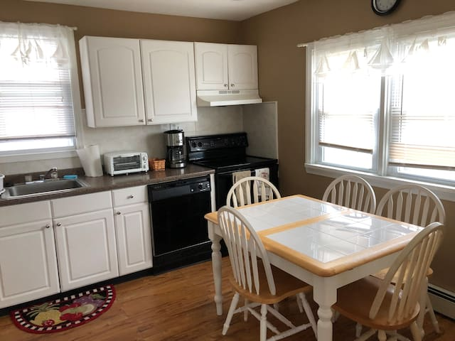 Large kitchen is complete with all appliances, cookware, dishes, glasses and garbage disposal.