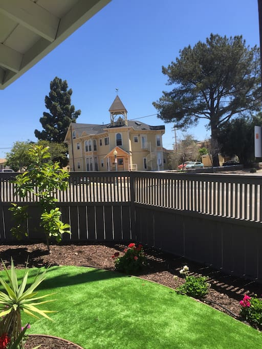 Beautiful Victorian home as your view from the yard