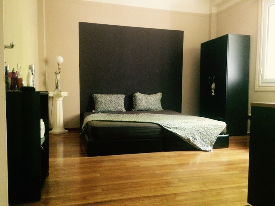 Double bed room with wardrobe, and study desk.