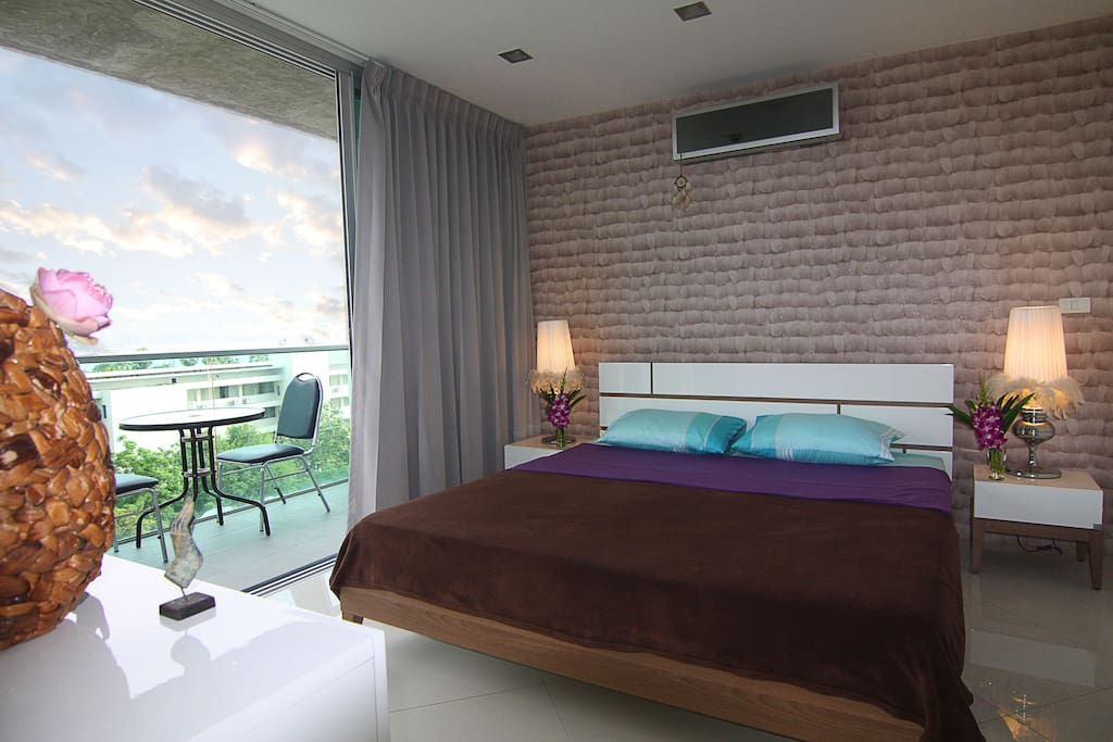 Spacious bedroom with king-size bed, on-suite bathroom, and sea-views balcony