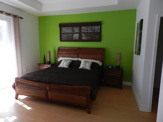 Master Bedroom with Kingsize bed, his and hers walk-in closed and en-suite bathroom