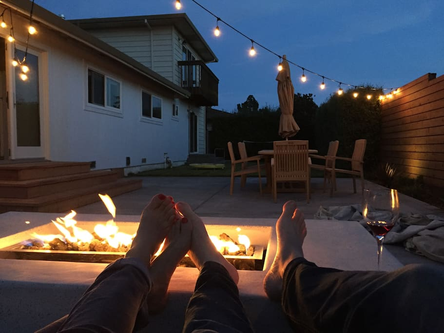 Outdoor fire pit at night.