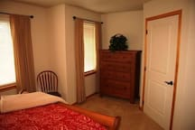 2nd bedroom view of walk-in closet and dresser to comfortably store your travel belongings.