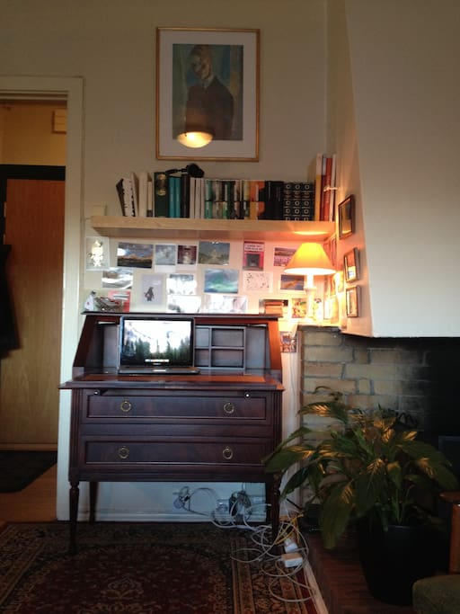 Fireplace and writing desk.