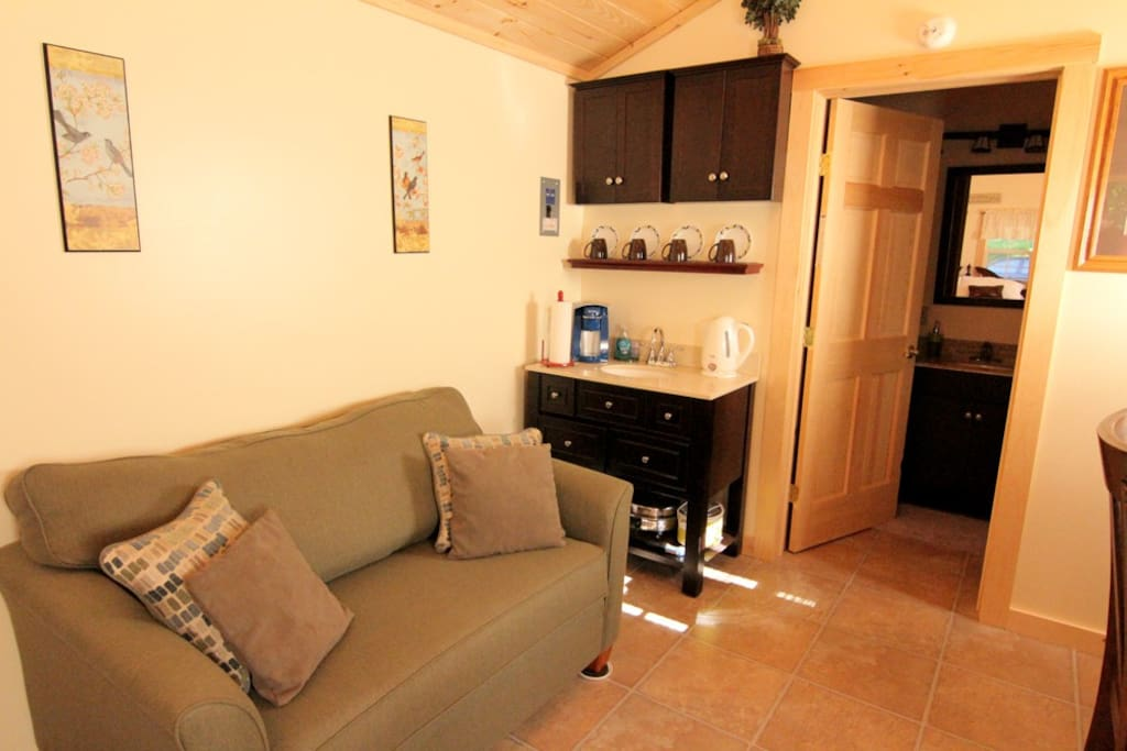 Relax on the sofa and watch a movie on the large flat panel TV, enjoy a cup of coffee or a glass of wine
