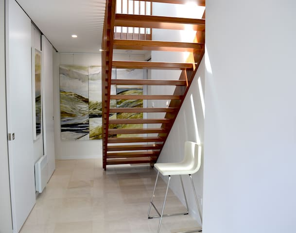 Saunter down stairs to the expansive bedrooms