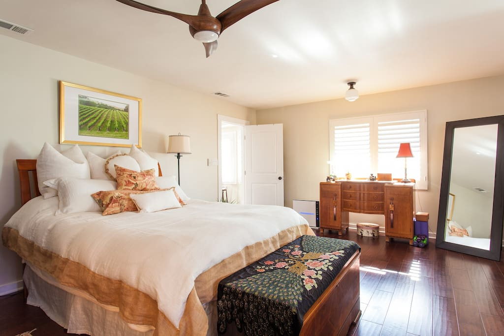 Tastefully decorated Master bedroom suite. Bedroom door locks.  Decorative ceiling fan.