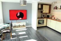 Living area & open plan kitchen