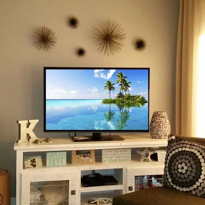Enjoy the Large Flat-Screen TV in the Living Room