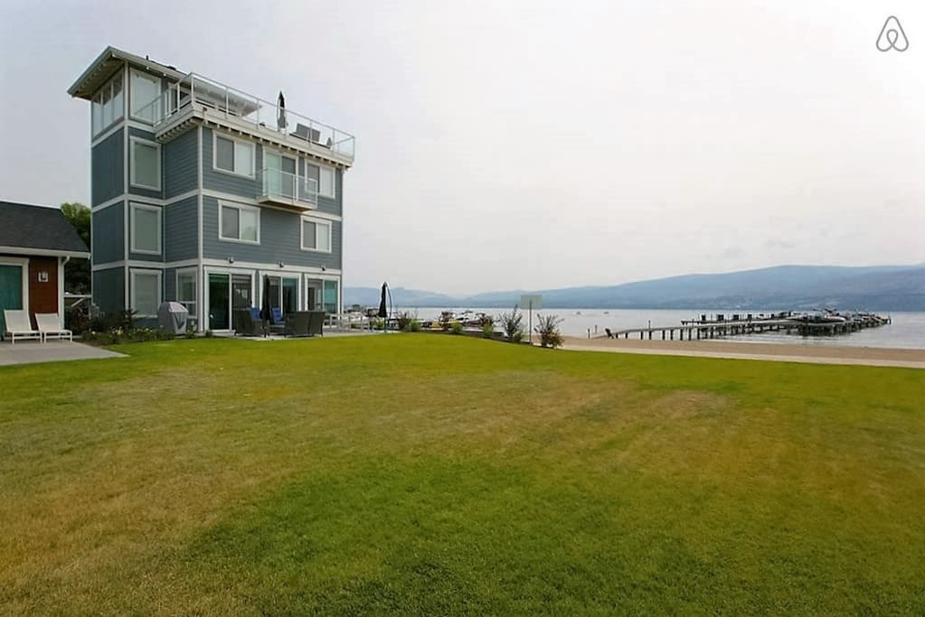Large grass play area meets the 35o ft. of sandy beach.  Just outside your door.