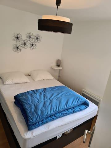 Chambre avec dimension lit Queen