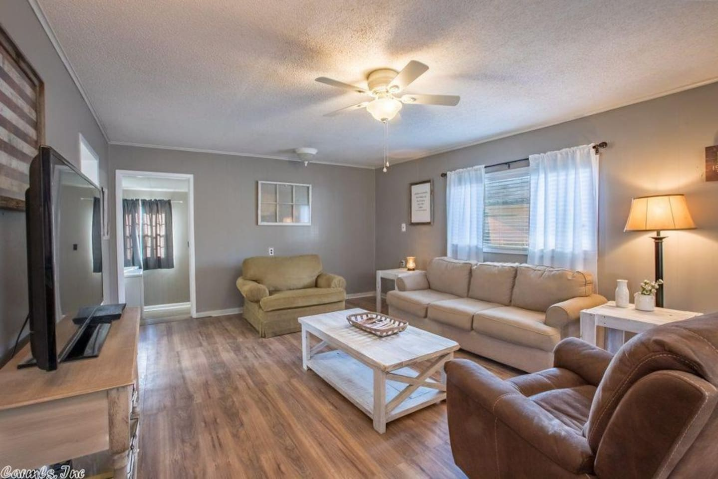 A large flat screen television and sofas for you to stretch out and relax